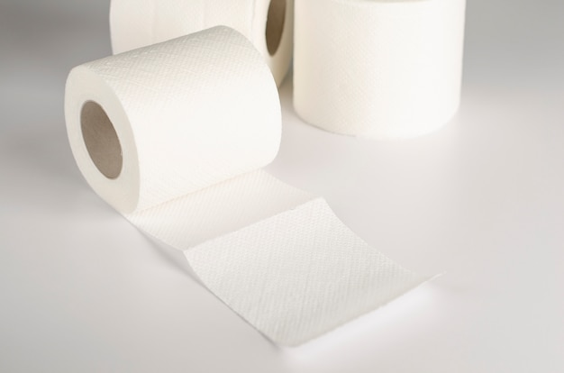 White toilet paper rolls on white
