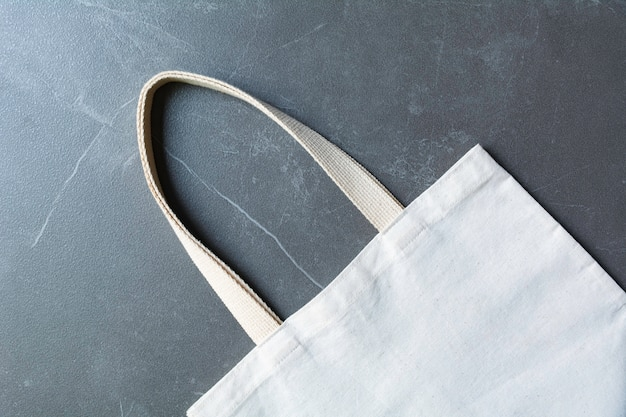 White tote bag canvas fabric. cloth shopping sack mockup with copy space.