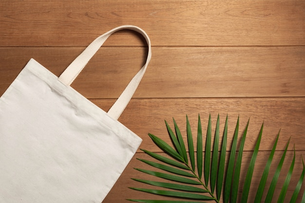 White tote bag canvas fabric on wooden background