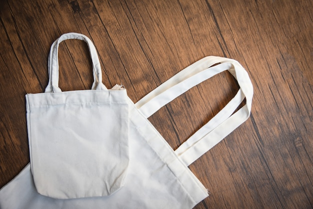 White tote canvas fabric eco bag cloth shopping sack on wooden