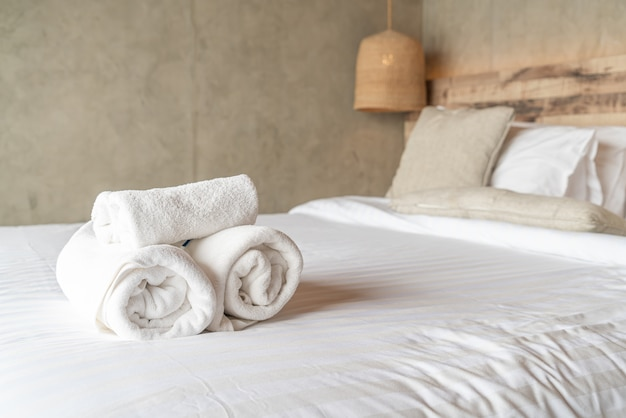 White towel on bed decoration in bedroom