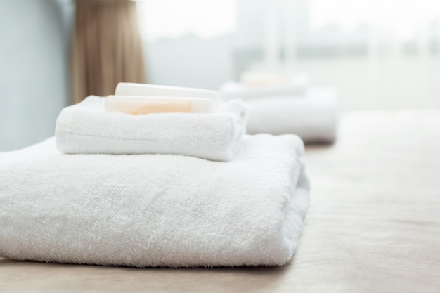 White towel on bed in guest room for hotel customer