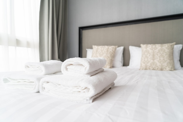 White towel decoration on bed