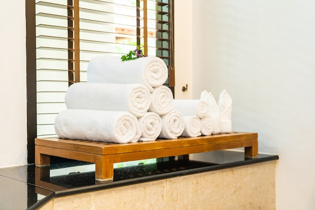 White towel on table in bathroom for take a bath or shower