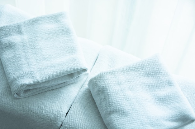 White towel on white mattress fabric, soft light in the morning.