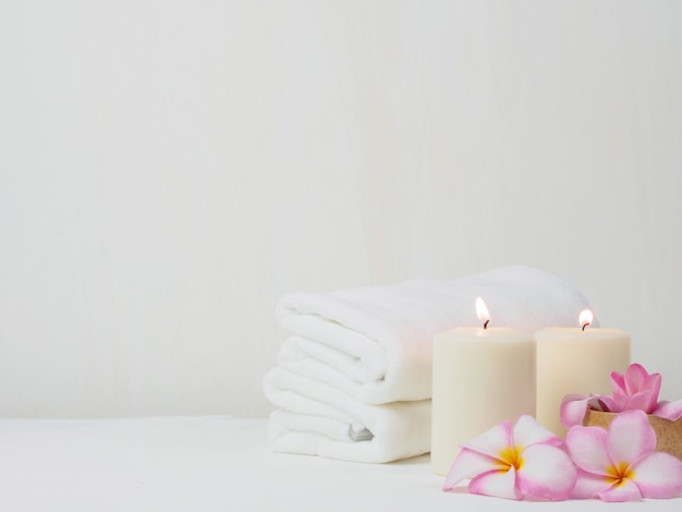 White towel with pink rose flower on the table