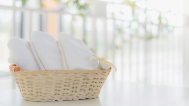 White towels in basket in bathroom