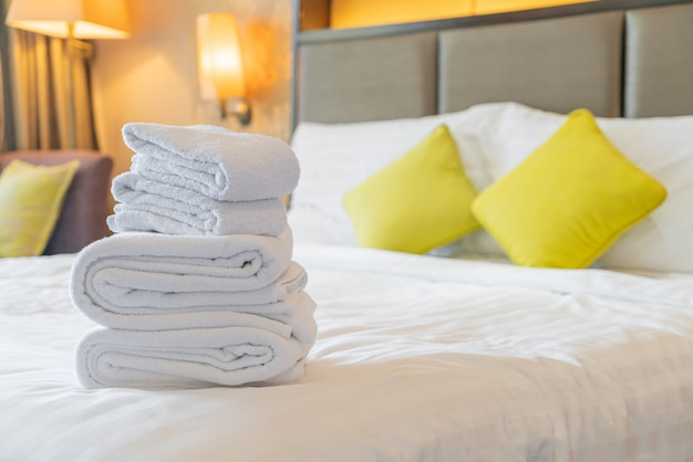 White towels folded on bed