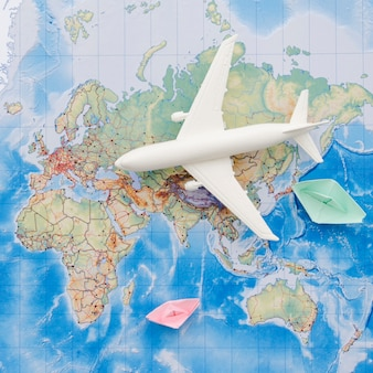 White toy plane on a map