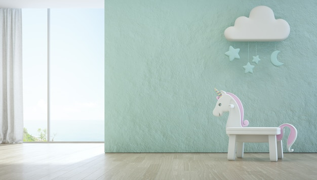 White toy unicorn on wooden floor of sea view kids room.
