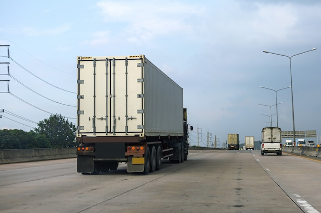 White truck on highway road with container