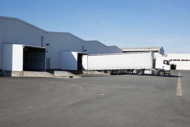 White truck at loading dock shipping industry