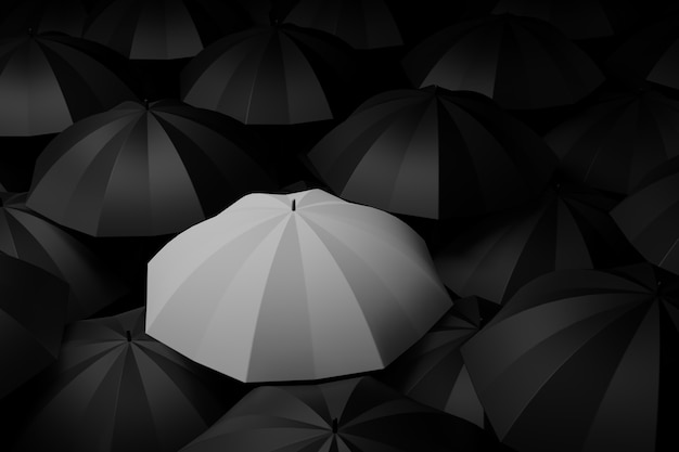 White umbrella in the midst of black. difference concepts