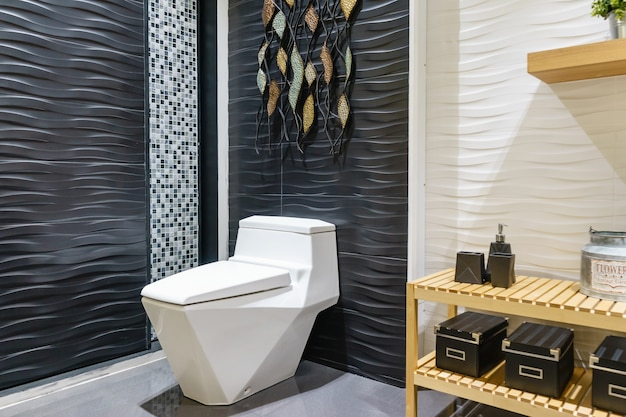 White urinal and washbasin and shower in granite bathroom
