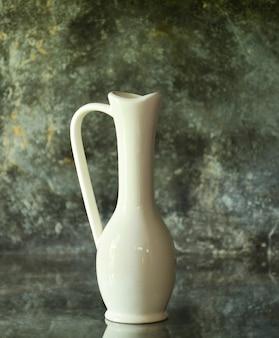 White vase on old glass desk for decorate in kitchen room
