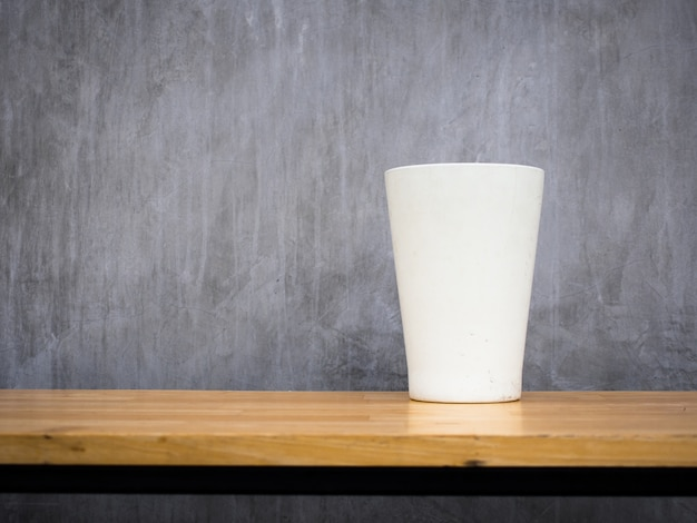 White vase placed on a wooden bench