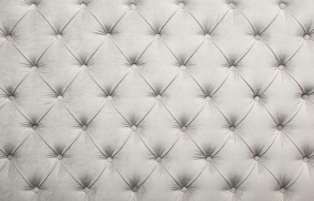 ホワイトベルベットチェスターフィールドスタイルのcapitoneテキスタイル背景ダイヤモンドパターン