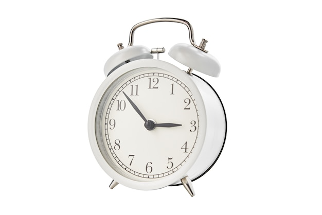 White vintage alarm clock on white background