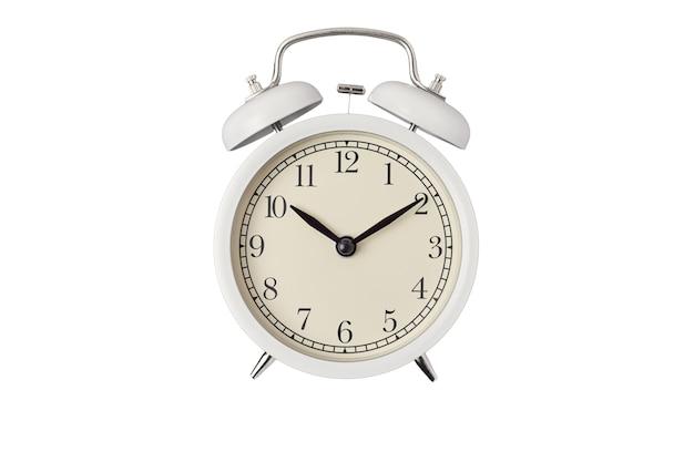 White vintage alarm clock on white background