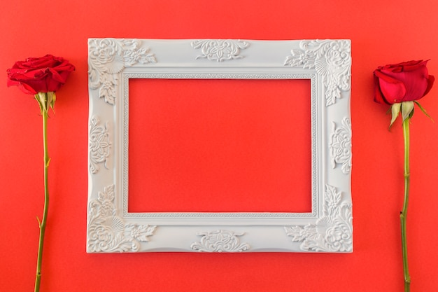 White vintage photo frame and fresh flowers