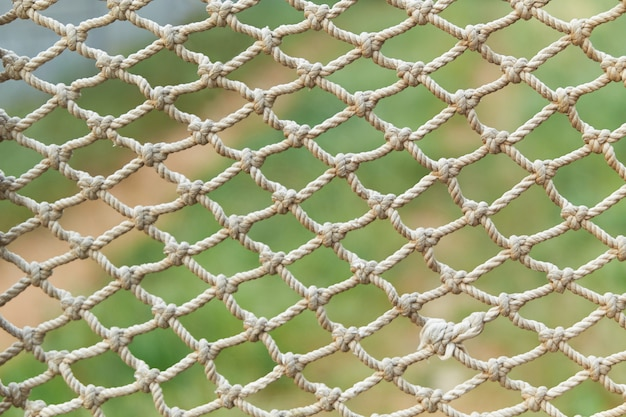 White vintage rope net texture on green grass