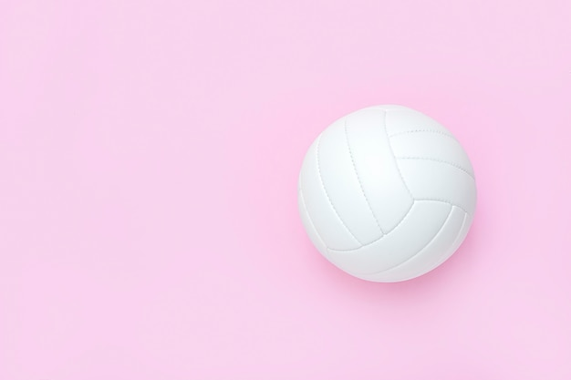 White volleyball leather ball on pink.