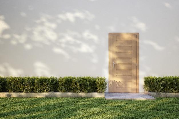 Белая стена на кустах с деревянной дверью, тень дерева на траве. 3d-рендеринг