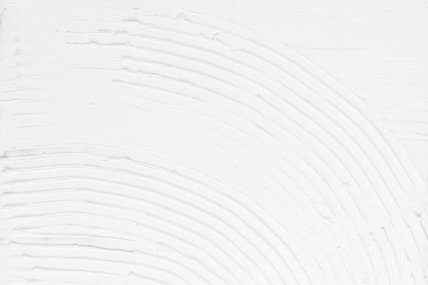 白い壁のペンキの織り目加工の背景