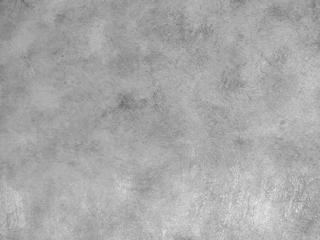 白い壁の傷のセメントの背景