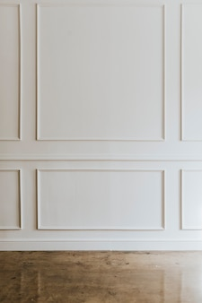 White wall with a brown marble floor