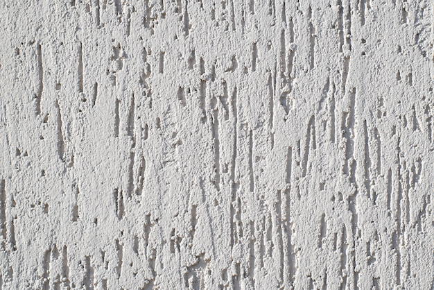 White wall with decorative trim. texture of the putty for external finishing. decorative scratches on the surface. copy space background