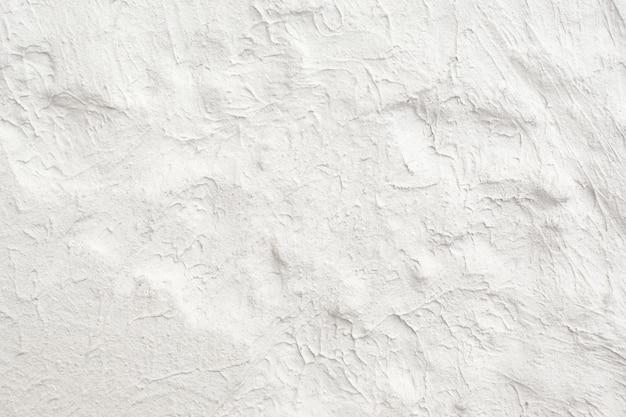 しっくい模様の白い壁
