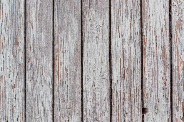 A white washed wooden surface worn out background