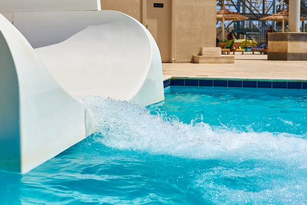 White water park slide and swimming pool.