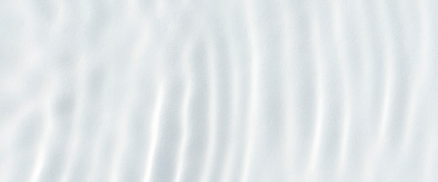 White wave abstract in sunlight or rippled water texture background. top view, flat lay. banner.