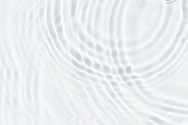 White wave abstract in sunlight or rippled water texture background. top view, flat lay.