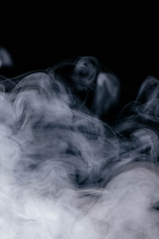 White wavy smoke on black background