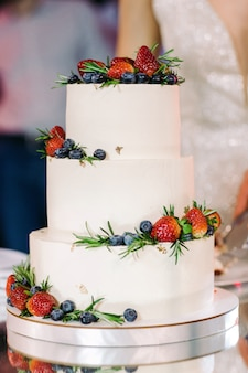 White wedding cake with fruit
