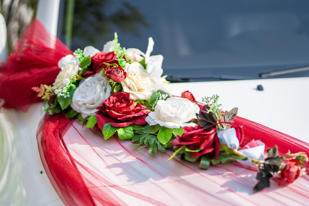 White wedding car decorated with fresh flowers. wedding decorations