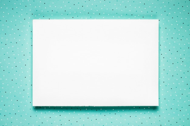 White wedding card on teal background