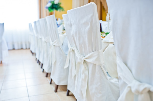 White wedding chairs on restaurant