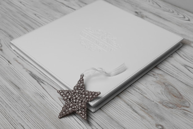 White wedding photo album on a wooden background