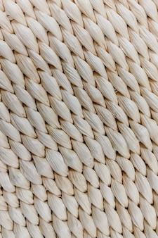 白い籐の家具の表面。テクスチャとして使用できます。