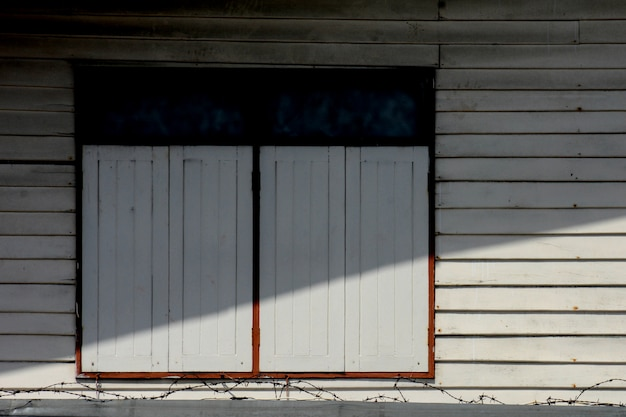 White window at antique wood house