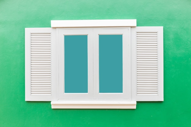 White window classic vintage on the color green wall background