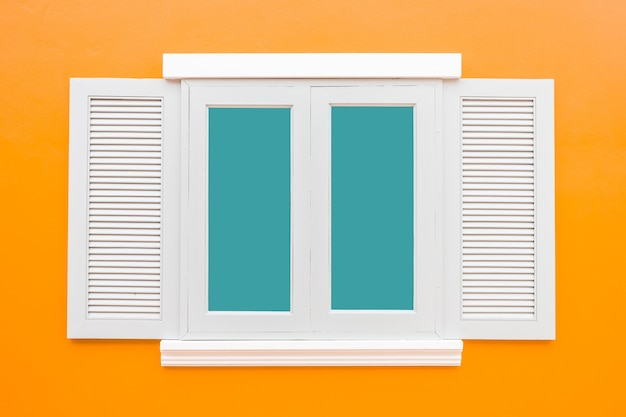 White window classic vintage on the color orange wall background