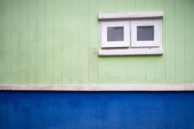 White window,green wall
