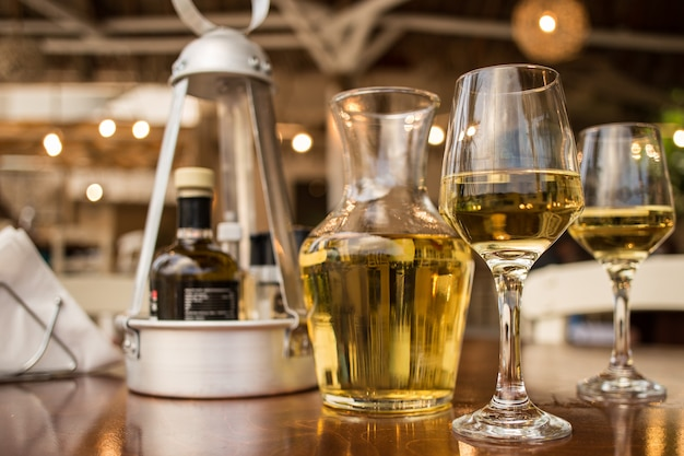 White wine in glasses on wooden table