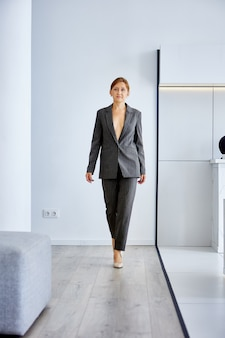 White woman in business suit on naked body