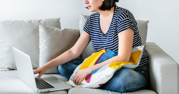 White woman using laptop